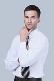 Closeup portrait of a confident handsome businessman