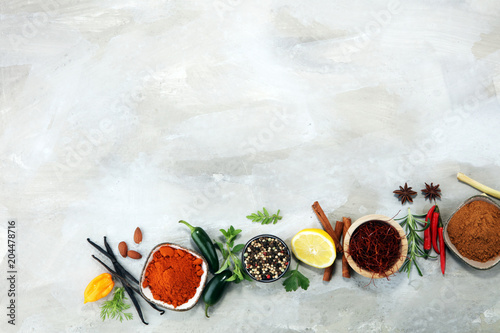 Wall mural Spices and herbs on table. Food and cuisine ingredients.