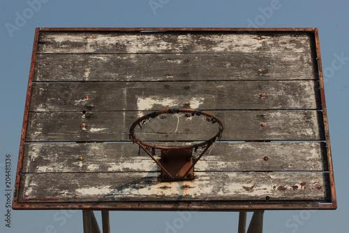 Fotobehang Basketbal Broken basketball hoop without net and a scratched backboard.