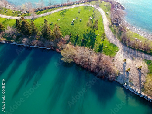 Canvas Canada Aerial bird eye view over Canadian island coastal park, green - blue morning calm water, beaches and harbour for leisure.