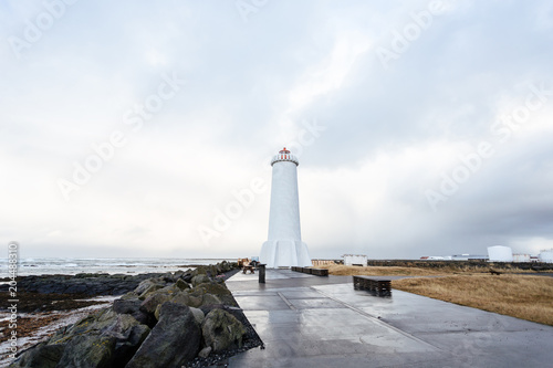 Fotobehang Vuurtoren Old lighthouse in Iceland on the edge of the cliff