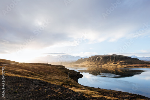 Wall mural Mountain road leading to the peaks in Iceland.