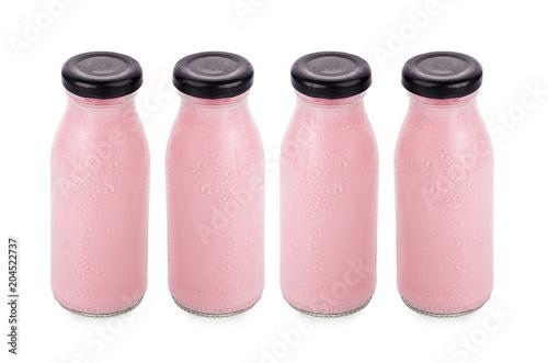Plexiglas Milkshake flavor of milk in bottles isolated on white background