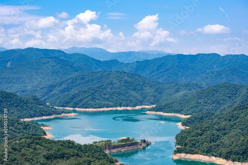 Fotobehang Blauwe jeans Thousand Island Lake from Shiding Crocodile Island at Feitsui Dam in Shiding District, New Taipei, Taiwan.