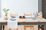 Canteen. wooden dining table with crockery and Cutlery. Light natural interior. Home comfort. - 204536954