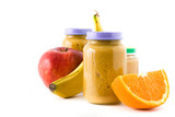 Baby food: Jar with fruit puree isolated on white background. Copyspace