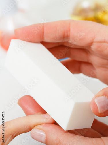 Plexiglas Manicure Preparing nails before manicure, beautician file nails