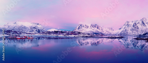Fotobehang Purper Landscape with beautiful winter lake and snowy mountains at sunset at Lofoten Islands in Northern Norway. Panoramic view
