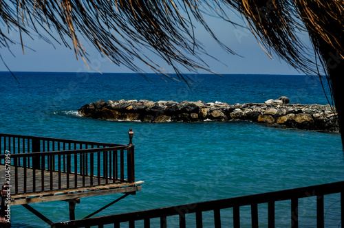 Fotobehang Tropical strand tropical beach with umbrellas made from dry leaves of palm trees