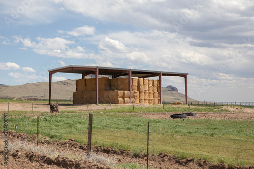 Fotobehang Blauwe hemel Hay Bales Stacked Under Storage Cover