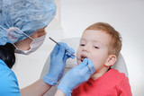 Dentist medical examination of child patient teeth using a mirror of instrument Caries, tooth damage, illness.