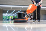 cleaning floor with machine - 204617538