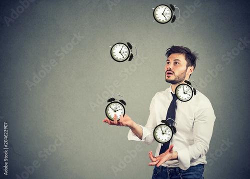 business man juggling his time alarm clocks - 204622907