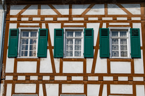 Facade of a half timbered house with three windows