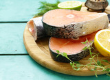 raw fish sea bass and salmon with lemon and herbs