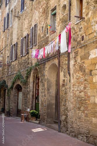 Fotobehang Toscane Washday in San Gimignano, Italy