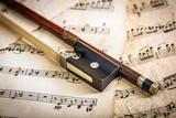 Violin bow on musical sheets