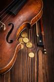 Violin waist detail on rustic wooden background
