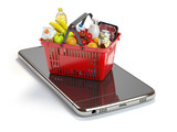 Smartphone and shopping basket with  food and drink. Online grocery supermarket concept. - 204666111