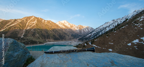 clarinet, mountain landscape and lake