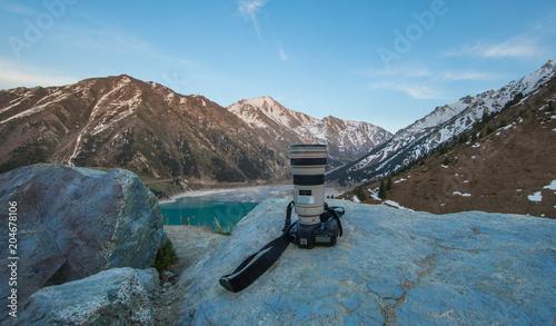Plexiglas Blauw camera on the mountain lake background