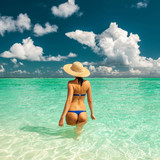 Woman in bikini at beach in Maldives