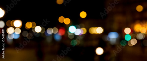 Bokeh traffic light at night in the street of a big city - 204694191