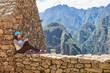 Woman sit in Machu Picchu