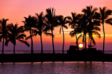 Setting sun with palm tree and boat silhouettes at Anaehoomalu Bay, Big Island, Hawaii - 204704779