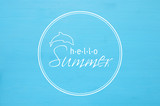 vacation and summer concept with text HELLO SUMMER over blue wooden background.