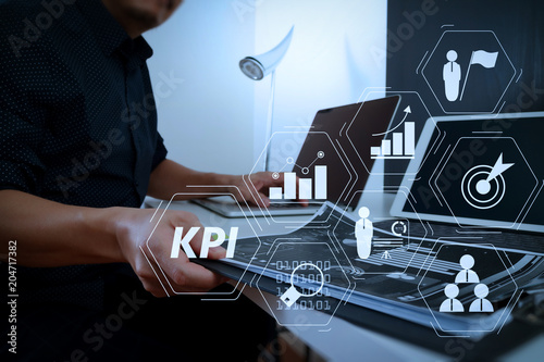 Wall mural businessman working with smart phone and digital tablet and laptop computer and document in modern office