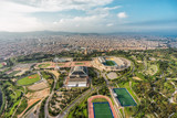 Barcelona aerial wide angle panorama, Anella Olimpica sport complex with city skyline , Spain
