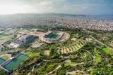 Barcelona aerial panorama, sport complex on the hill with city skyline , Spain