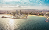 Barcelona skyline aerial view with skyscrapers by the beach, Spain. Vintage colors