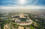 Barcelona aerial panorama, Anella Olimpica sport complex on the hill with city skyline , Spain. Sunbeam light