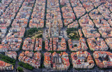 Aerial view of Barcelona Eixample residencial district and Sagrada familia inside typical urban squares, Spain. Late afternoon soft light