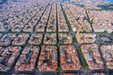 Barcelona aerial wide angle view, Eixample residencial district urban area, Spain. Late afternoon light