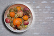 Fruit bowl on grey washed brick wall background texture for copy space - 204742308