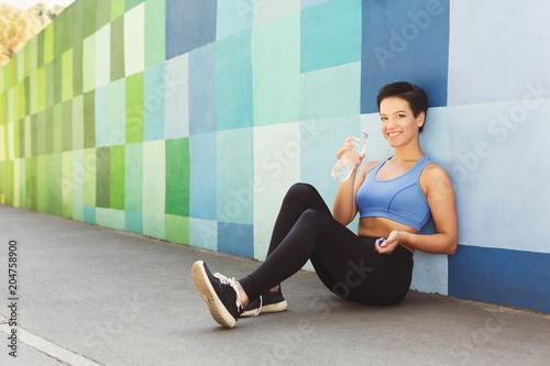 Aluminium Graffiti Woman choose music to listen during workout