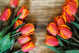 Tulips on a wooden board - 204763755
