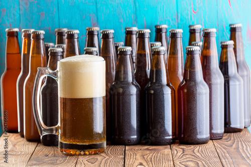 Fototapeta Selection of multiple unlabelled bottles of beer