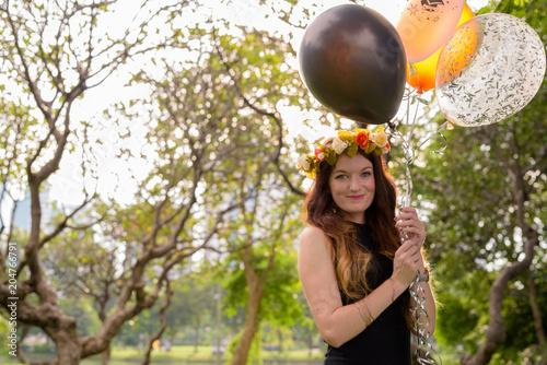 Young beautiful woman celebrating graduation at the park in Bang