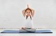 Leinwanddruck Bild - child girl doing yoga and gymnastics in gym
