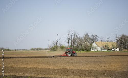 Aluminium Trekker Seeding crops at field - Tractor working on the field