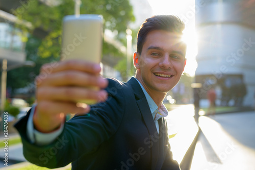 Fototapeta Young handsome businessman exploring the city