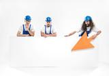 Three handsome craftsmen holding an empty white board - 204799308