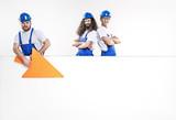 Three handsome craftsmen posing next to the empty white board - 204799364