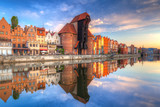 Beautiful old town of Gdansk reflected in Motlawa river at sunrise, Poland. - 204802560