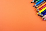 Pencils set on orange tone color paper. Empty space for text and design. Minimalism concept. - 204804341