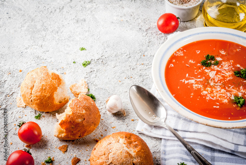 Tomato soup, Gazpacho in white bowl on grey stone background, with ingredients  Copy space - 204805749